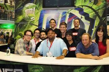 The Chuck team at the Warner Bros. booth. From left to right: Creators/executive producers Chris Fedak and Josh Schwartz as well as stars Joshua Gomez, Mark Christopher Lawrence, Zachary Levi (behind Mark), Ryan McPartlin, Vik Sahay, Adam Baldwin, Scott Krinsky and Sarah Lancaster. (Copyright 2010 WBEI)