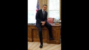 President Barack Obama sits on the front of the Resolute Desk while talking with business representatives during a meeting in the Oval Office prior to their Rose Garden event, , April 30, 2010. (Official White House Photo by Pete Souza)