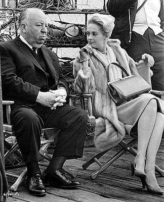 http://www.hollywoodoutbreak.com/wp-content/uploads/2012/08/alfred-hitchcock-and-tippi-hedren-on-set-of-the-birds.jpg